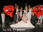 Gruppenbild mit Brautpaaren